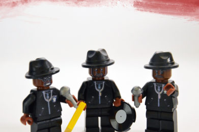 "Run-DMC Lego minifigure created by Bloom Design, Joseph ""Run"" Simmons, Darrell ""DMC"" McDaniels, Jason ""Jam Master Jay"" Mizell"